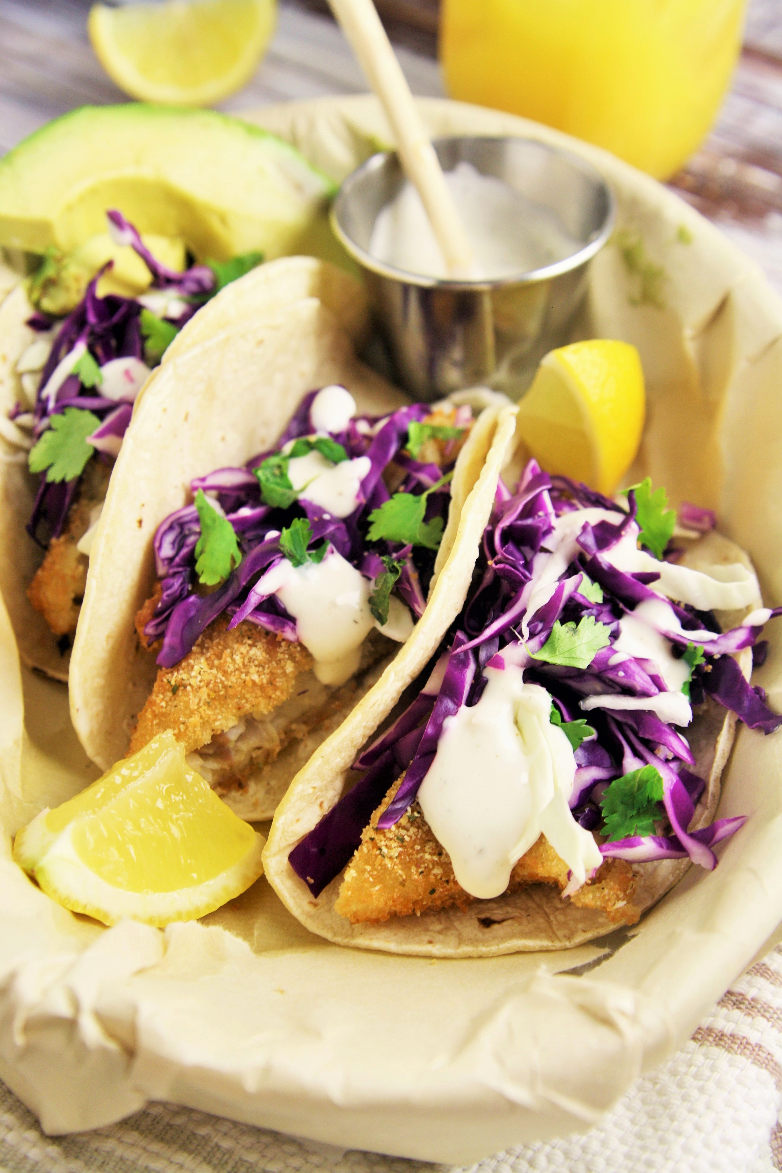 Crispy fish tacos with cabbage slaw and lime crema the for Cabbage slaw for fish tacos